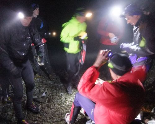 Night runners on the top of Morven on the shortest day of the year